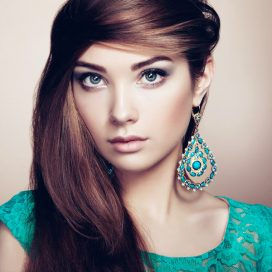 portrait-of-beautiful-young-woman-with-earring-PAJ3QFJ