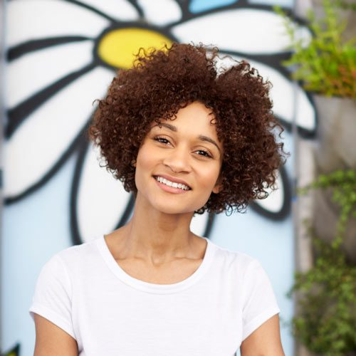 outdoor-head-and-shoulders-portrait-of-smiling-GWFXMSP