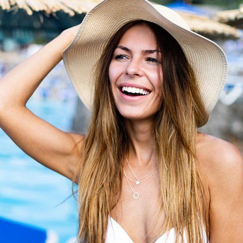 beautiful-sexy-woman-in-bikini-on-beach-during-NFEP6Y5