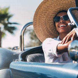 black-woman-driving-a-vintage-convertible-car-BFYH7K3