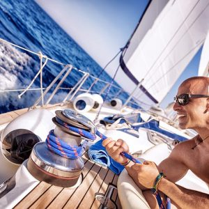 handsome-strong-man-working-on-sailboat-PYVQQJQ