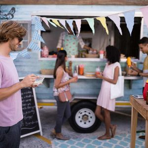 customers-having-snacks-from-food-truck-EDLBVPX