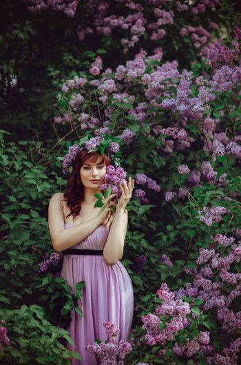 beautiful-girl-in-purple-dress-with-lilac-flowers-FPDYXV6
