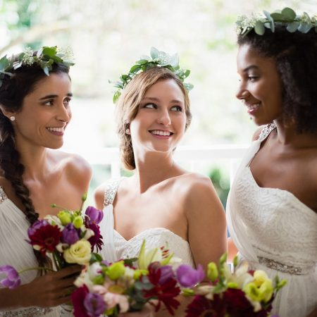 bride-and-bridesmaids-standing-with-bouquet-WUP98TF