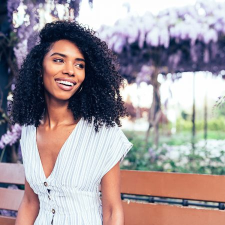 happy-young-black-woman-sitting-surrounded-by-LG4PBF3
