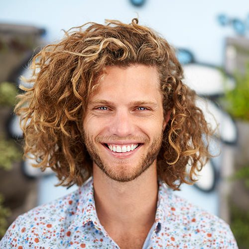 outdoor-head-and-shoulders-portrait-of-smiling-MSB8T45
